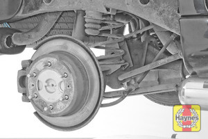 Illustration of step: Take a good look around the brake system and the suspension arm, checking for any leaks - step 15