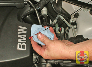 Illustration of step:  Using a clean rag or paper towel remove all oil from the dipstick - Models with a dipstick - step 12