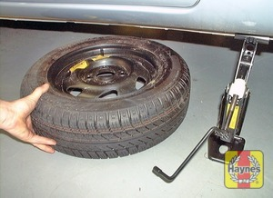 Illustration of step:  Turn the jack handle clockwise until the wheel is raised clear of the ground - step 6