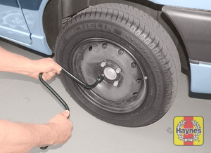 Illustration of step:  Using the wheelbrace, slacken each wheel bolt by half a turn - step 8