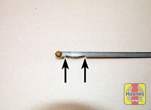 Illustration of step:  Note the oil level on the end of the dipstick, which should be between the upper (MAX) mark and lower (MIN) mark - Car Care - step 16