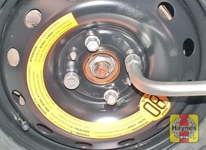 Illustration of step:  Fit the spare wheel, and screw in the bolts - step 7