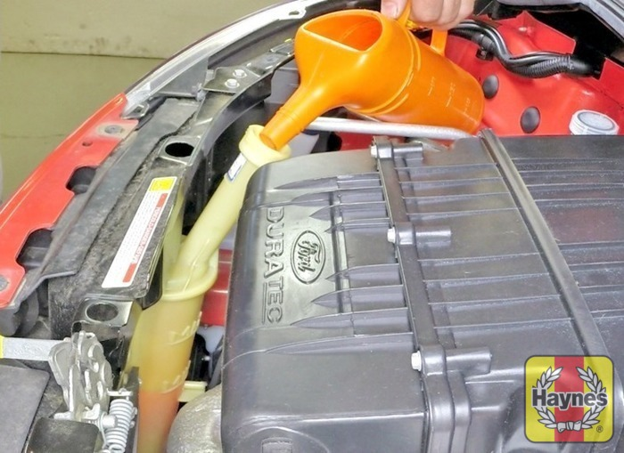 Illustration Of Step Add A Mixture Of Water And Antifreeze To The Expansion Tank Until