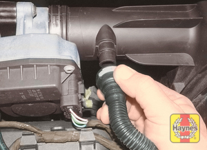 Illustration of step:  Depress the quick-release fitting and detach the breather hose from the air cleaner lid  - 1.6 litre models and post-September 2002 1.4 litre models - step 10