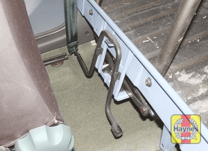 Illustration of step:  The jack and wheelbrace are stored behind the driver's seat on Van models  - step 2
