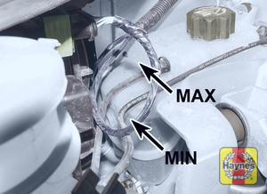 Illustration of step:  On all post-September 2002 petrol and diesel models, the level is checked in the expansion tank located on the right-hand side of the engine compartment - Car Care - step 23