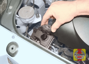 Illustration of step: d On post-September 2002 models, the power steering fluid reservoir is integral with the power steering pump, located at the front of the engine -  Safety first! - step 39