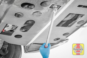 Illustration of step: Use a 21mm spanner or socket to carefully remove the sump plug and fully drain the oil - step 3