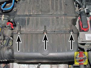Illustration of step:  Undo the 3 screws above and below the cover  - SOHC 8v models - step 2