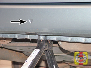 Illustration of step:  Position the head of the jack under the sill jacking point  - Changing the wheel - step 11