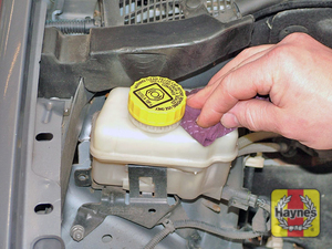 Illustration of step:  Wipe around the filler cap  - Safety first! - step 34