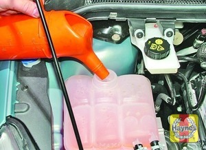 Illustration of step:  Add a mixture of water and antifreeze to the expansion tank until the coolant level is halfway between the level marks - Car care - step 19