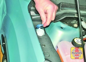 Illustration of step:  The washer fluid reservoir filler neck is located in the right-hand rear corner of the engine compartment - Washer fluid level - step 43
