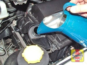 Illustration of step:  Oil is added through the filler cap - Vehicle care - step 14