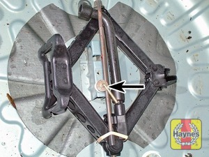 Illustration of step:  Unscrew the retaining bolts, then lift the spare wheel and jack/tools out - Changing the wheel - step 3