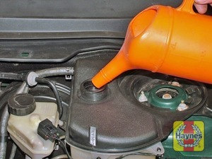 Illustration of step:  Add a mixture of water and antifreeze to the expansion tank until the coolant level is halfway between the level marks - Car care - step 15