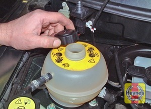 Illustration of step:  If topping-up is necessary, wait until the engine is cold, then slowly unscrew the expansion tank filler cap anti-clockwise to release any pressure in the system, and remove it - Vehicle Care - step 19