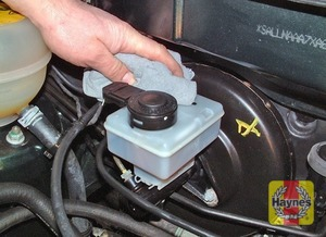 Illustration of step:  If topping-up is necessary, wipe the area around the filler cap with a clean rag before removing the cap - Safety first! - step 28