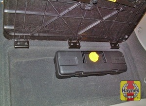 Illustration of step:  The spare wheel is fitted to a bracket on the rear door - step 2