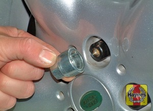 Illustration of step:  Using the wheel nut brace, unscrew the retaining nuts and remove the spare wheel from the bracket - step 3