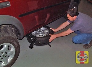 Illustration of step:  The spare wheel is fitted to a bracket on the rear door - step 8