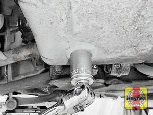 Illustration of step: Using a 21mm spanner or socket, carefully remove the sump plug and fully drain the oil - step 4