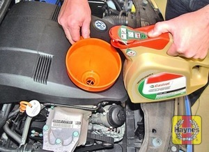 Illustration of step:  Use a funnel to reduce spillage when adding engine oil  - step 20