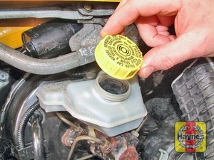 Illustration of step:  Unscrew the reservoir cap and remove it -  Safety first! - step 27