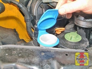 Illustration of step:  The reservoir for the washer systems is located on the front right-hand side of the engine compartment - Screen washer fluid level - step 39