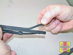Illustration of step:  Check the condition of the wiper blades; if they are cracked or show any signs of deterioration, or if the glass swept area is smeared, renew them - step 6