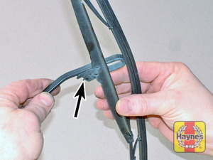 Illustration of step:  To remove a windscreen wiper blade, pull the arm fully away from the windscreen until it locks - step 7