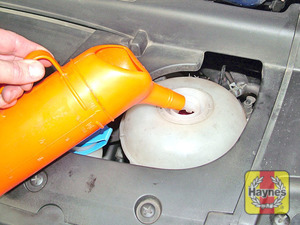 Illustration of step:  Add a mixture of water and antifreeze to the expansion tank until the coolant level is halfway between the level marks - Vehicle care - step 20