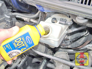 Illustration of step:  Carefully add fluid, taking care not to spill it onto the surrounding components - Safety first! - step 32