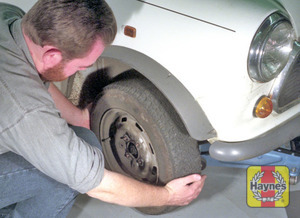 Illustration of step:  Fit the spare wheel, and screw in the nuts - step 6
