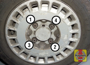Illustration of step:  Securely tighten the wheel nuts in the sequence shown then refit the wheel trim cap - step 7