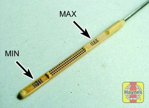 Illustration of step:  Note the level on the end of the dipstick, which should be between the upper (MAX) mark and lower (MIN) mark - Vehicle care - step 12