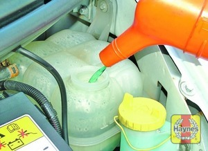 Illustration of step:  Add a mixture of water and antifreeze to the expansion tank until the coolant is up to the MAX level mark - Vehicle care - step 19