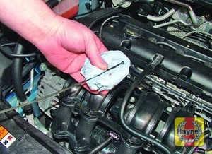 Illustration of step:  Using a clean rag or paper towel remove all oil from the dipstick - Car care - step 10