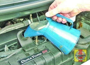 Illustration of step:  Oil is added through the filler cap - Vehicle care - step 13