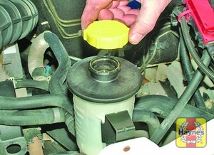 Illustration of step:  If topping-up is required, wipe clean the area around the reservoir filler neck and unscrew the filler cap from the reservoir - Safety first! - step 37