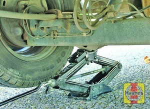 Illustration of step:  The rear jacking points for front wheel drive vehicles are under the rear eyes of the leaf spring, or under the axle as near to the wheel as possible - step 9