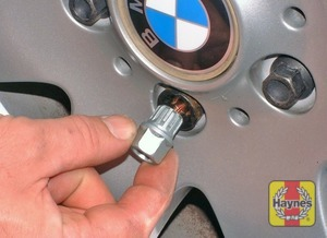 Illustration of step:  Remove the wheel trim/hub cap (as applicable) then slacken each wheel bolt by a half turn - step 6