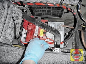 Illustration of step:  Check battery is generally secure, if loose, tighten the battery retainer If you have to replace the battery or alternator, click below  - step 6