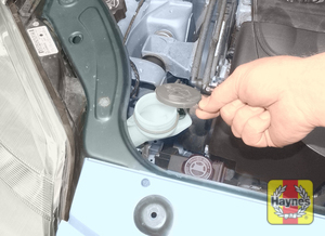 Illustration of step:  The washer fluid reservoir is located at the front right-hand side of the engine compartment - Screen washer fluid level - step 29