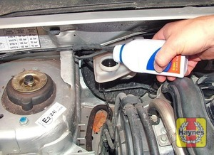 Illustration of step:  Carefully add fluid, avoiding spilling it on surrounding paintwork -  	Safety first! - step 49