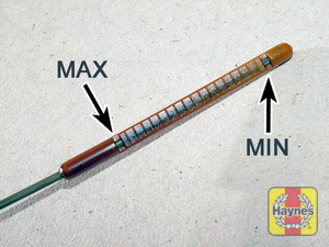 Illustration of step:  Note the oil level on the end of the dipstick, which should be between the upper (MAX) mark and lower (MIN) mark - Car care - step 12