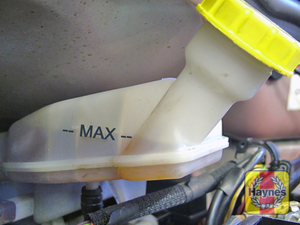 Illustration of step:  The MAX and MIN marks are indicated on the side of the reservoir, which is located on the front of the vacuum servo unit in the engine compartment - Safety first! - step 29