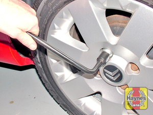 Illustration of step:  Using the wheelbrace, slacken each wheel bolt by half a turn - Changing the wheel - step 9