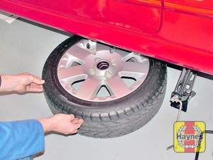 Illustration of step:  Unscrew the wheel bolts and remove the wheel, then place the wheel under the vehicle sill in case the jack fails - Changing the wheel - step 11