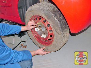 Illustration of step:  Fit the spare wheel and screw in the bolts - Changing the wheel - step 12